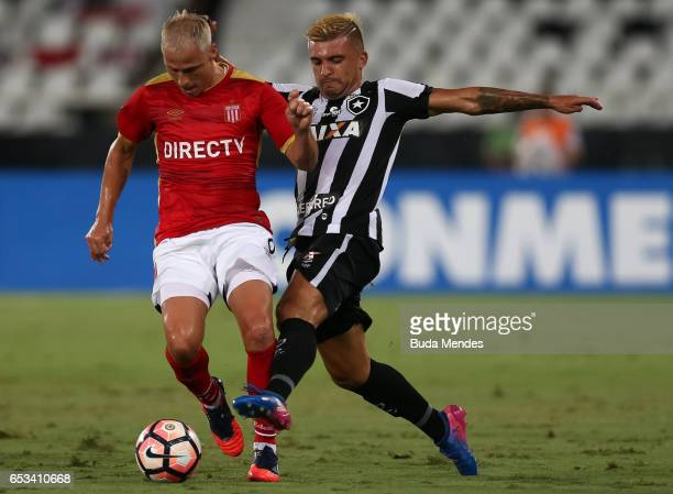 Victor Luis of Botafogo struggles for the ball with Israel Damonte of Estudiantes during a match between Botafogo and Estudiantes as part of Copa...