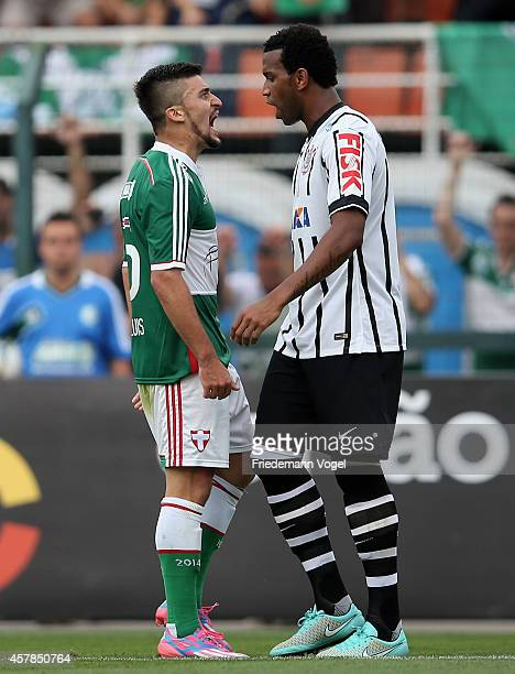 Victor Luis of Palmeiras speaks with Gil of Corinthians during the match between Palmeiras and Corinthians for the Brazilian Series A 2014 at Estadio...