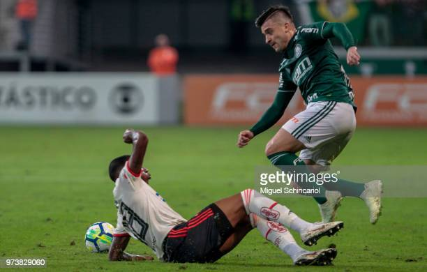 Victor Luis of Palmeiras vies the ball with Jean Lucas of Flamengo during a match between Palmeiras and Flamengo for the Brasileirao Series A 2018 at...