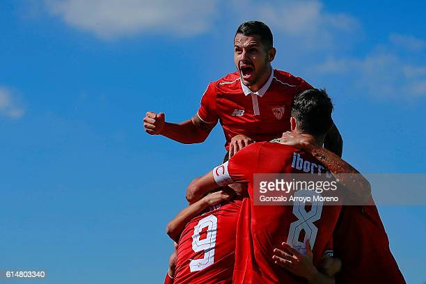 Victor Machin alias Vitolo of Sevilla FC jumps celebrating his teammate Samir Nasri«s goal over Luciano Vietto and Vicente Iborra during the La Liga...