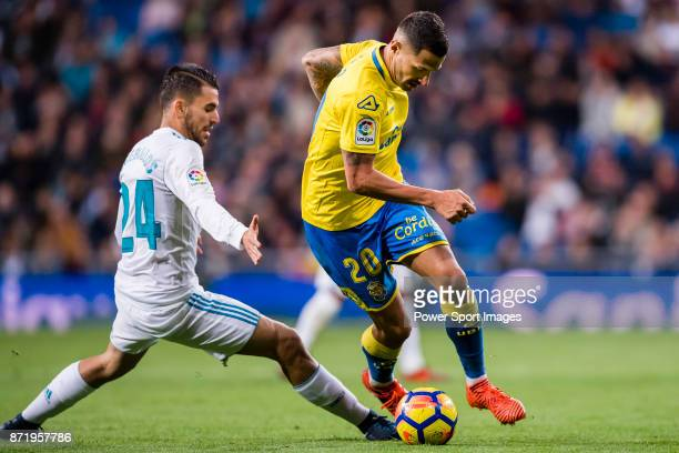 Victor Machin Perez of UD Las Palmas fights for the ball with Daniel Ceballos Fernandez D Ceballos of Real Madrid during the La Liga 201718 match...