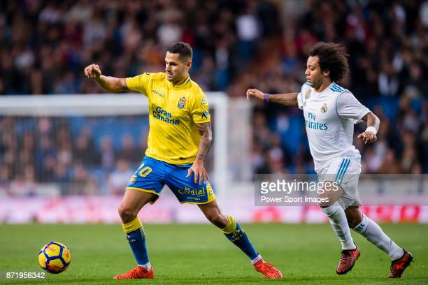 Victor Machin Perez of UD Las Palmas fights for the ball with Marcelo Vieira Da Silva of Real Madrid during the La Liga 201718 match between Real...