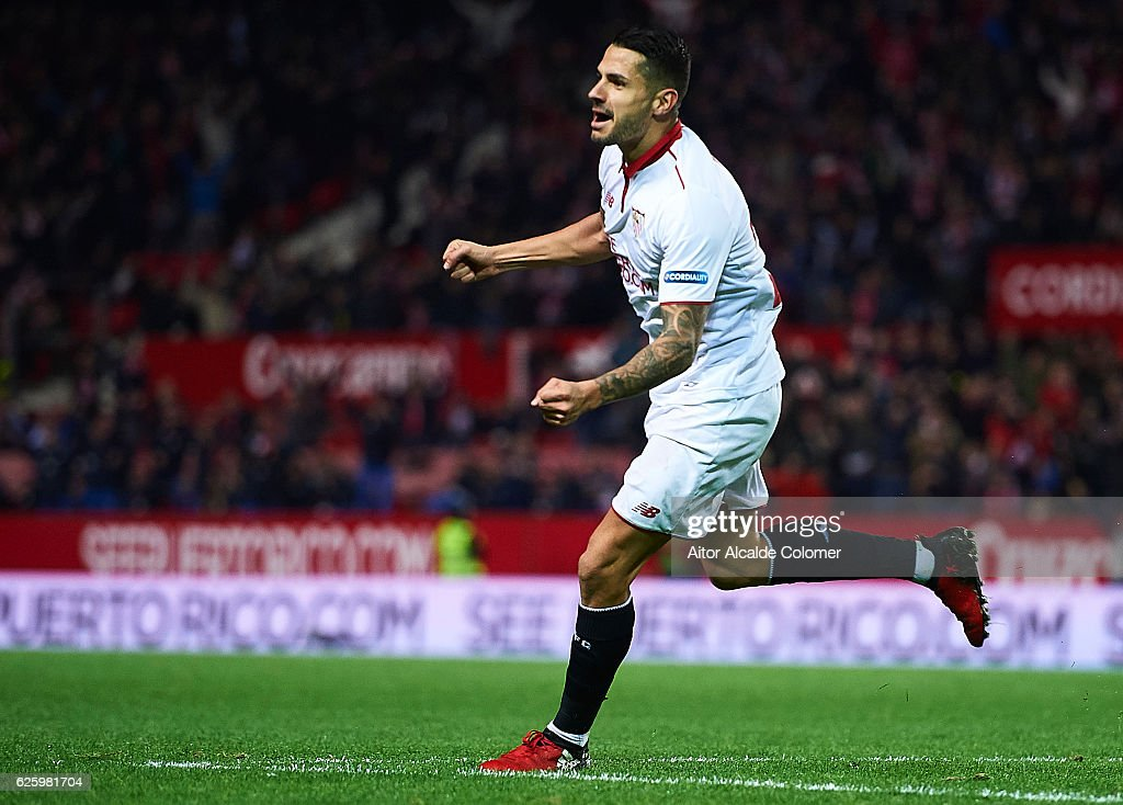 Victor Machin Perez 'Vitolo' celebrates after his shot is deflected by Ezequiel Garay of Valencia CF and scoring an own goal during the La Liga match between Sevilla FC and Valencia CF at Estadio Ramon Sanchez Pizjuan on November 26, 2016 in Seville, Spain.