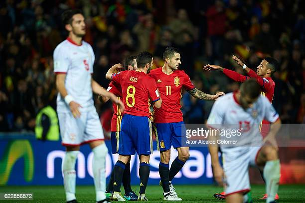 Victor Machin Perez 'Vitolo' celebrates with Koke Resurreccion and Thiago Alcantara of Spain after scoring during the FIFA 2018 World Cup Qualifier...