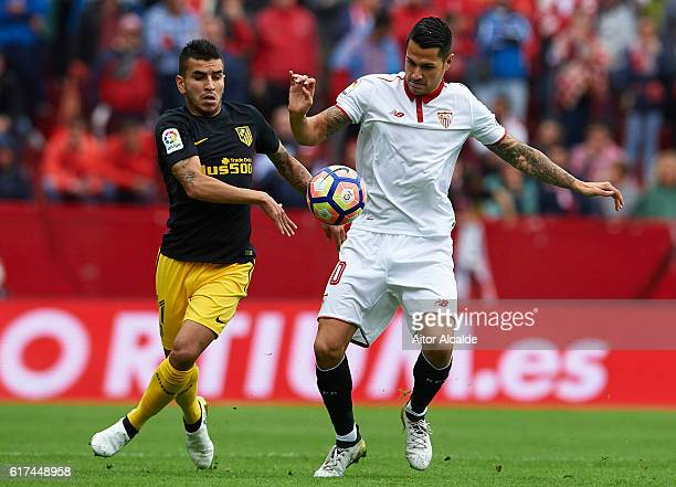 Victor Machin Perez 'Vitolo' of Sevilla FC being followed by Angel Correa of Club Atletico de Madrid on during the match between Sevilla FC vs Club...