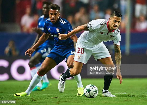 Victor Machin Perez 'Vitolo' of Sevilla FC being followed by Corentin Tolisso of Olympique Lyonnais during the UEFA Champions League Group H match...