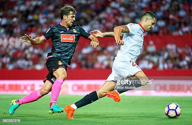 Victor Machin Perez Vitolo of Sevilla FC being followed by Victor Sanchez of RCD Espanyol during the match between Sevilla FC vs RCD Espanyol as part...