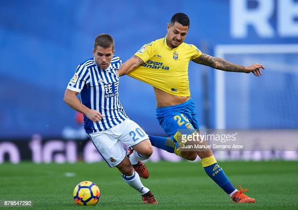 Victor Machin Perez 'Vitolo' of UD Las Palmas duels for the ball with Kevin Rodrigues of Real Sociedad during the La Liga match between Real Sociedad...