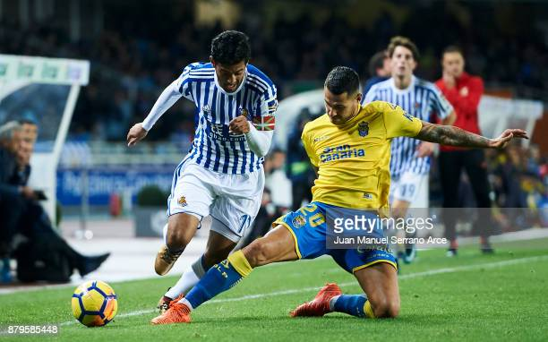 Victor Machin Perez 'Vitolo' of UD Las Palmas duels for the ball with Carlos Vela of Real Sociedad during the La Liga match between Real Sociedad de...