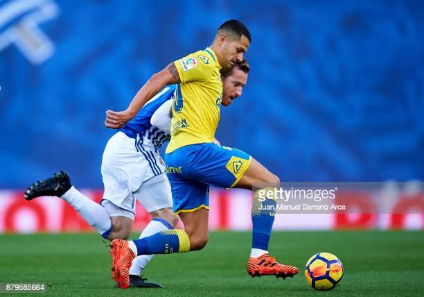 Victor Machin Perez 'Vitolo' of UD Las Palmas duels for the ball with David Zurutuza of Real Sociedad during the La Liga match between Real Sociedad...