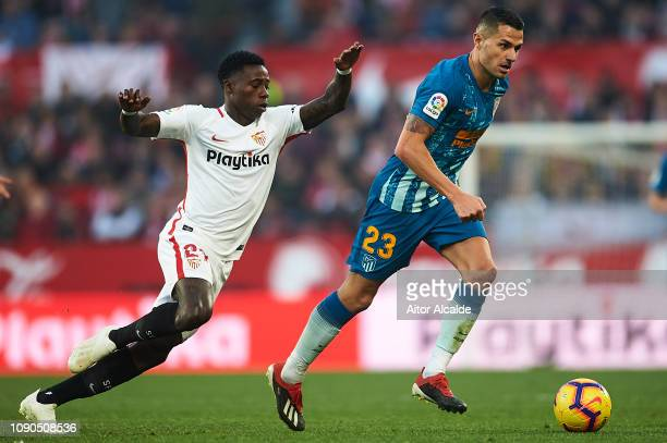 Victor Machin Vitolo of Club Atletico de Madrid being followed by Quincy Promes of Sevilla FC during the La Liga match between Sevilla FC and Club...