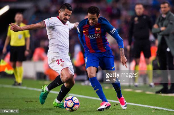 Victor Machin 'Vitolo' of Sevilla FC fouls Neymar Santos Jr of FC Barcelona during the La Liga match between FC Barcelona and Sevilla FC at Camp Nou...