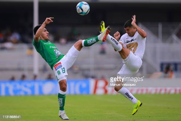 Victor Malcorra of Pumas struggles for the ball against Angel Mena of Leon during the 8th round match between Pumas UNAM and Leon as part of the...