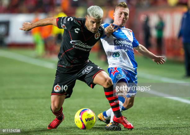 Victor Malcorra of Tijuana and Alejandro Chumacero of Puebla fight for the ball during the 4th round match between Tijuana and Puebla as part of the...