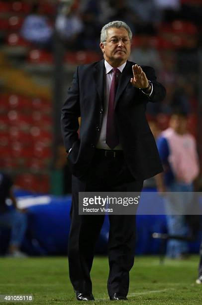 Victor Manuel Vucetich coach of Queretaro gives instructions to his platers during the 12th round match between Queretaro and Tijuana as part of the...