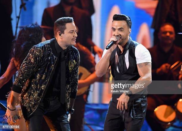 Victor Manuelle and Luis Fonsi perform onstage at the 18th Annual Latin Grammy Awards at MGM Grand Garden Arena on November 16 2017 in Las Vegas...