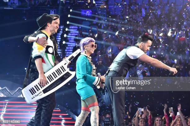 Victor Manuelle Simon Mejia Li Saumet and Luis Fonsi peform onstage during The 18th Annual Latin Grammy Awards at MGM Grand Garden Arena on November...