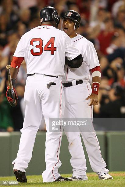 Victor Martinez of the Boston Red Sox celebrates with David Ortiz after Martinez scored in the sixth inning against the New York Yankees on April 4,...