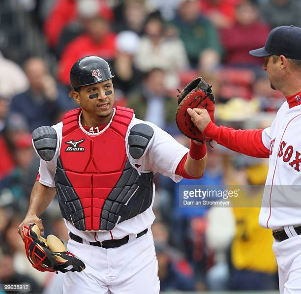 Victor Martinez of the Boston Red Sox high fives Red Sox pitcher Tim Wakefield during the game between the Toronto Blue Jays and the Boston Red Sox...