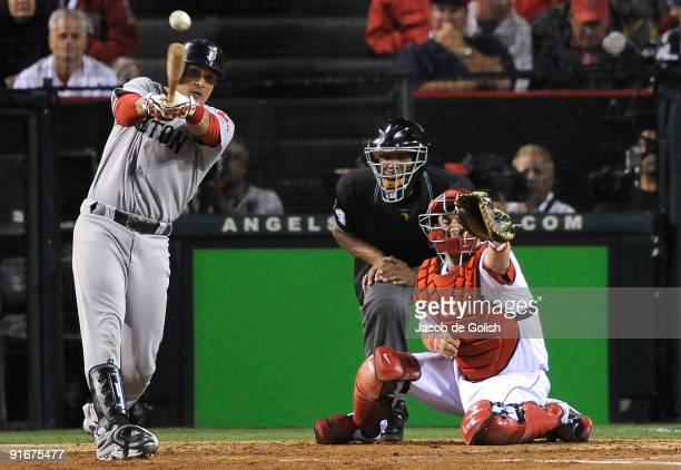 Victor Martinez of the Boston Red Sox hits a single to score Jacoby Ellsbury fourth inning of Game Two of the ALDS against the Los Angeles Angels of...