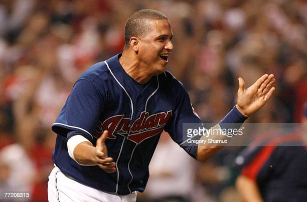 Victor Martinez of the Cleveland Indians celebrates after Travis Hafner hit a gamewinning RBI single to score Kenny Lofton in the bottom of the 11th...