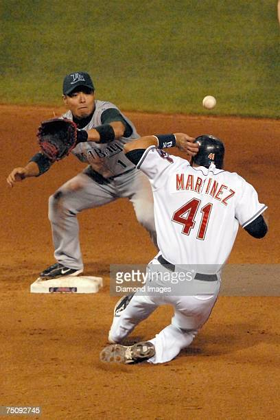 Victor Martinez of the Cleveland Indians is hit in the helmet by a throw to Tampa Bay Devil Rays third baseman Akinori Iwamura from Carlos Pena in...