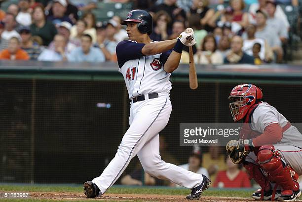 Victor Martinez of the Cleveland Indians swings at the pitch during the game against the Anaheim Angels on September 4 2004 at Jacobs Field in...