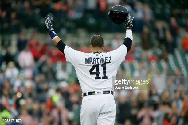Victor Martinez of the Detroit Tigers acknowledges the fans as he leaves the field after hitting a single during the first inning of a game against...