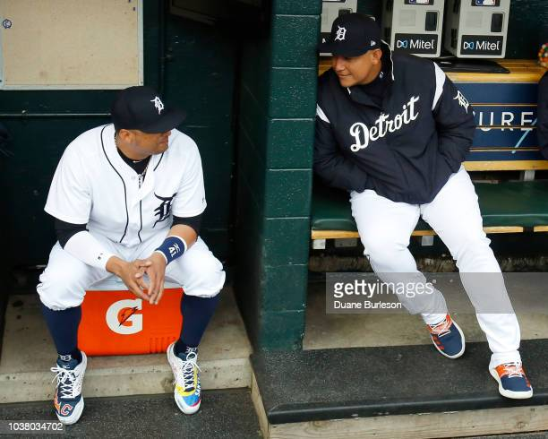 Victor Martinez of the Detroit Tigers and Miguel Cabrera of the Detroit Tigers chat before a ceremony honoring Martinez who is playing his last game...