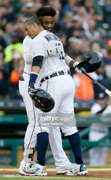 Victor Martinez of the Detroit Tigers and Niko Goodrum of the Detroit Tigers share a hug as Martinez leaves the game for a pinch runner after hitting...