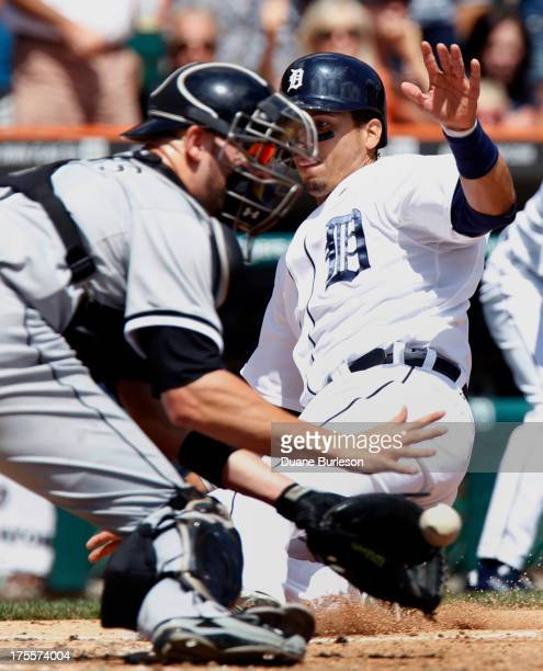 Victor Martinez of the Detroit Tigers beats the throw to catcher Tyler Flowers of the Chicago White Sox to score on a double by Alex Avila in the...