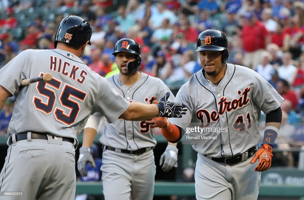 Victor Martinez #41 of the Detroit Tigers celebrates a two-run homerun with John Hicks #55 in the first inning against the Texas Rangers at Globe Life Park in Arlington on May 8, 2018 in Arlington, Texas.