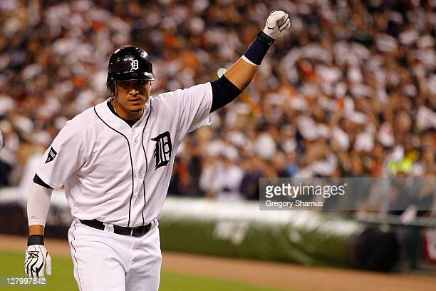 Victor Martinez of the Detroit Tigers celebrates after hitting a solo home run in the fourth inning against the New York Yankees during Game Four of...