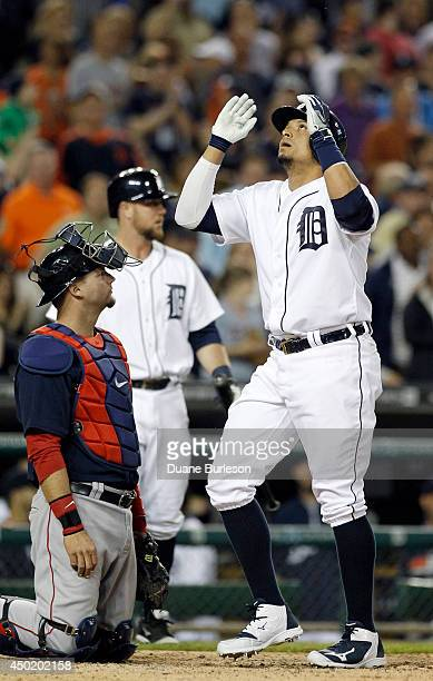 Victor Martinez of the Detroit Tigers celebrates his eighth inning home run in front of catcher AJ Pierzynski of the Boston Red Sox at Comerica Park...