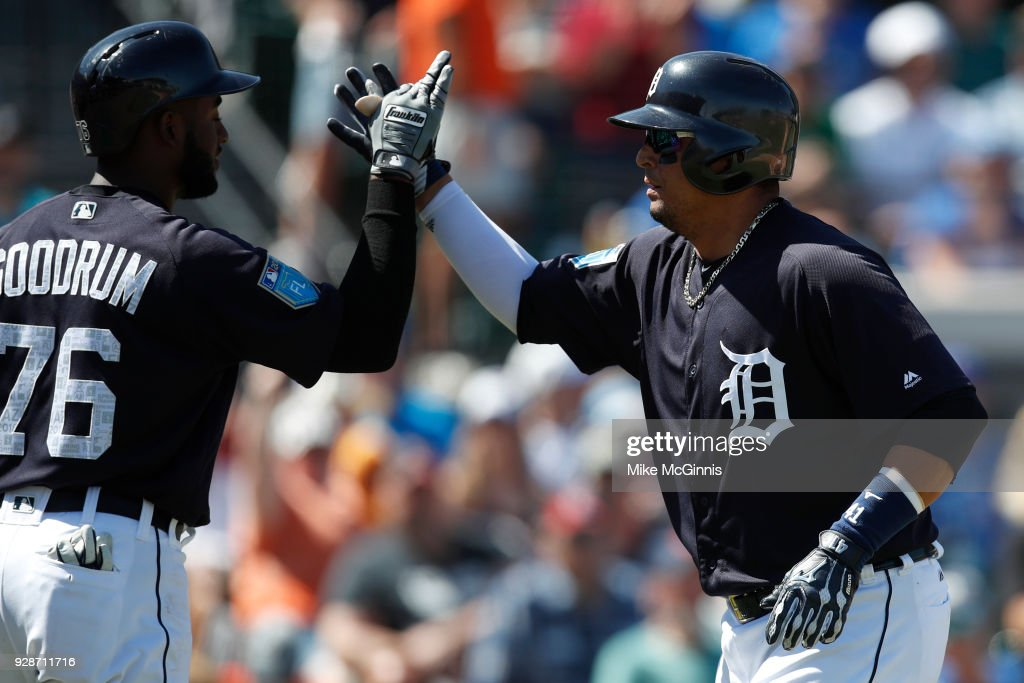 Victor Martinez #44 of the Detroit Tigers celebrates with Niko Goodrum #76 after hitting a solo home run during the second inning of the spring training game against the Toronto Blue Jays at Joker Marchant Stadium on March 07, 2018 in Lakeland, Florida.