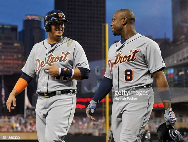 Victor Martinez of the Detroit Tigers congratulates teammate Justin Upton on threerun home run against the Minnesota Twins during the third inning of...