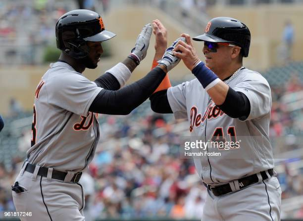 Victor Martinez of the Detroit Tigers congratulates teammate Niko Goodrum on tworun home run against the Minnesota Twins during the fourth inning of...