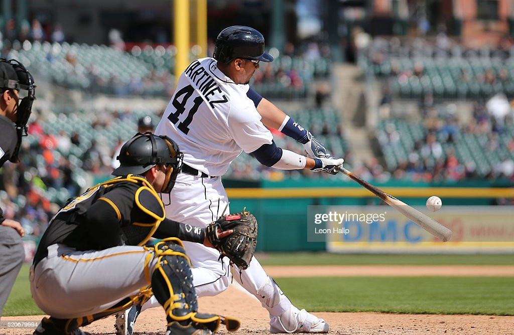 Victor Martinez #41 of the Detroit Tigers doubles to deep center field scoring Ian Kinsler and Justin Upton (not in photo) during the sixth inning of the inter-league game against the Pittsburgh Pirates on April 12, 2016 at Comerica Park in Detroit, Michigan.