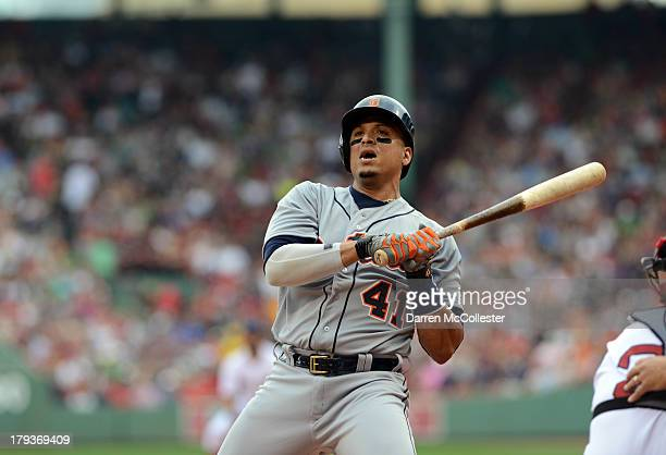 Victor Martinez of the Detroit Tigers ducks a pitch in the first inning against the Boston Red Sox at Fenway Park on September 2 2013 in Boston...