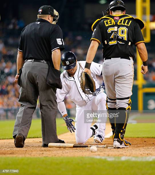 Victor Martinez of the Detroit Tigers gets up after being hit by a pitch in the eighth inning of an interleague game against the Pittsburgh Pirates...