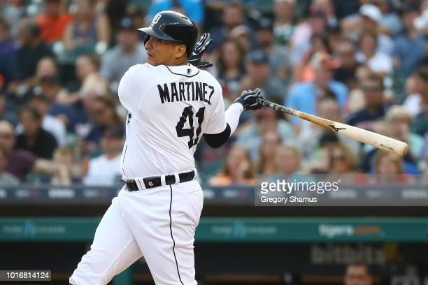 Victor Martinez of the Detroit Tigers hits a first inning double to score two runs while playing the Chicago White Sox at Comerica Park on August 14...