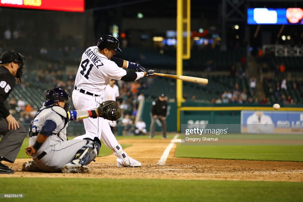 Victor Martinez #41 of the Detroit Tigers hits a ninth inning single that scores two runs in front of Jesus Sucre #45 of the Tampa Bay Rays at Comerica Park on April 30, 2018 in Detroit, Michigan. Tampa Bay won the game 3-2.