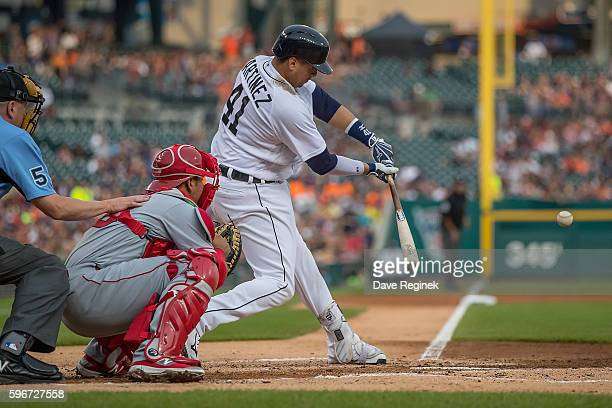 Victor Martinez of the Detroit Tigers hits a single in the first inning during a MLB game against the Los Angeles Angels at Comerica Park on August...