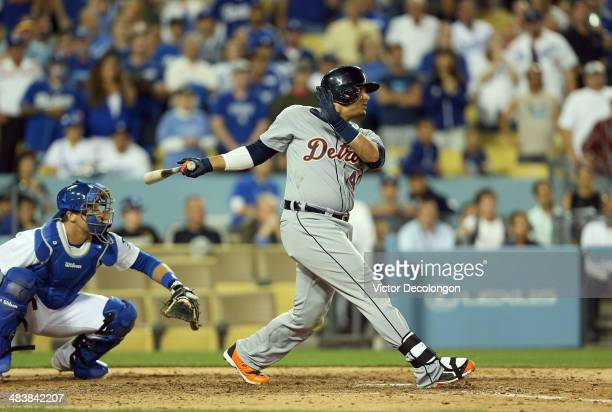 Victor Martinez of the Detroit Tigers hits a single to center against pitcher Kenley Jansen of the Los Angeles Dodgers to score teammate Ian Kinsler...