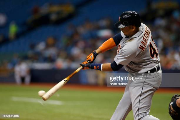 Victor Martinez of the Detroit Tigers hits a single to right field off of pitcher Matt Andriese of the Tampa Bay Rays during the first inning of a...