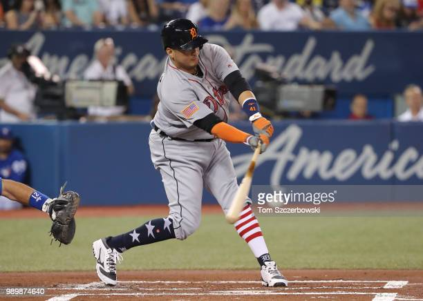 Victor Martinez of the Detroit Tigers hits an RBI single in the first inning during MLB game action against the Toronto Blue Jays at Rogers Centre on...