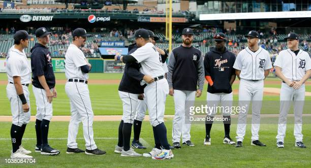 Victor Martinez of the Detroit Tigers hugs his teammates during his retirement ceremony before the final game of his career against the Kansas City...