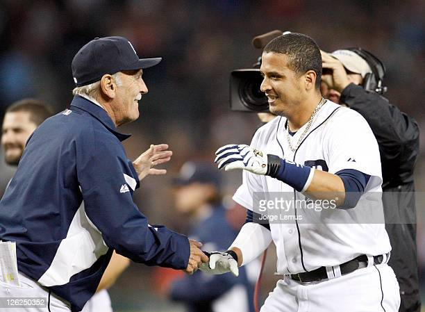 Victor Martinez of the Detroit Tigers is congratulated by manager Jim Leyland after his single against the Baltimore Orioles provided a 43 victory in...