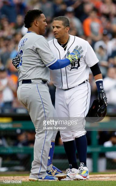 Victor Martinez of the Detroit Tigers is congratulated by Salvador Perez of the Kansas City Royals as Martinez leaves the game for a pinch hitter...