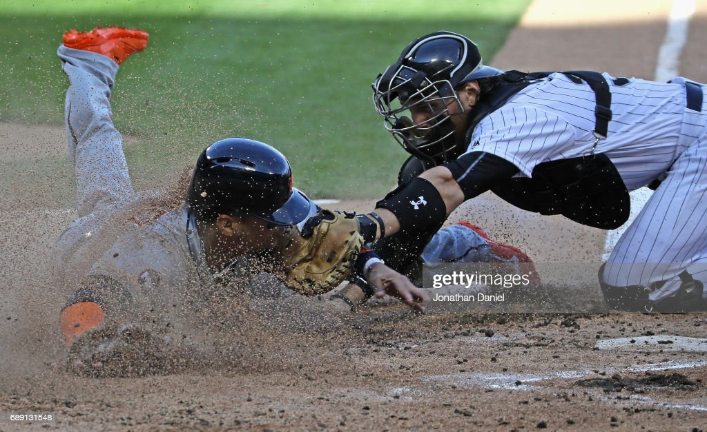 Victor Martinez #41 of the Detroit Tigers is tagged out at the plate by Kevan Smith #36 of the Chicago White Sox in the 2nd inning in game two at Guaranteed Rate Field on May 27, 2017 in Chicago, Illinois.
